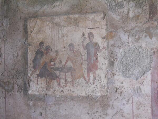 Un immagine di giocatori ad una caupona (osteria) in via Mercurio a Pompei dove si gioca a tabula. (credit: archivio personale di Monica Silvestri)