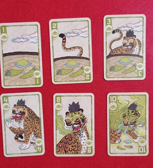 Per ogni spezia le carte formano una storiella dove una tigre si avvicina e rimane